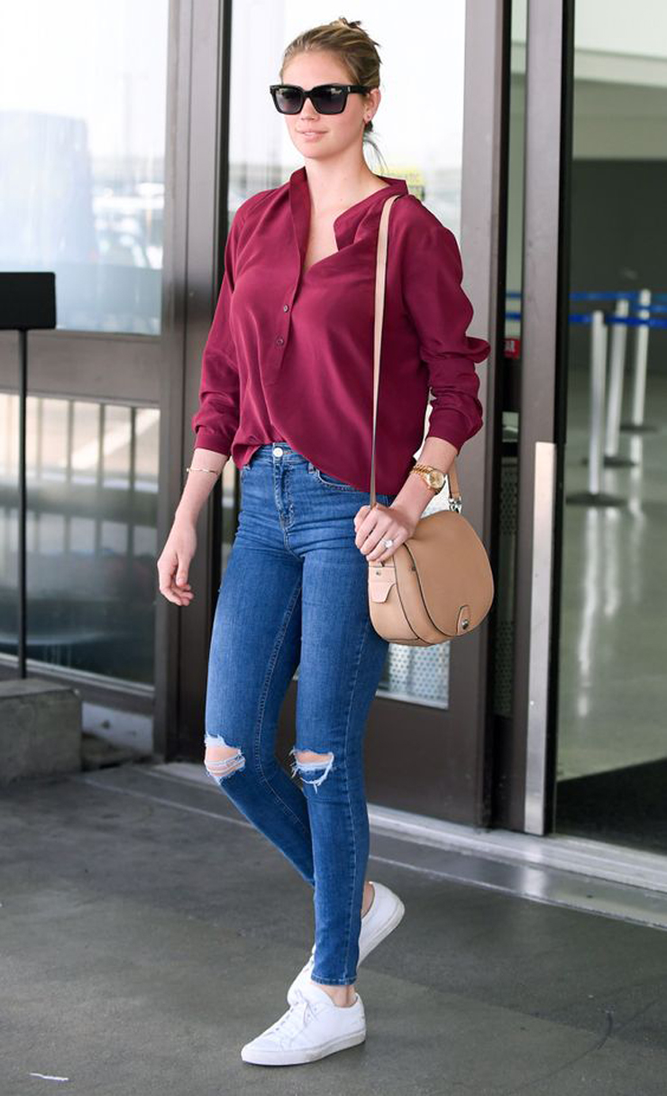 07/15/2016 EXCLUSIVE: Kate Upton looks fantastic as she arrives to Los Angeles this afternoon. The 24 year old American model and actress strolled confidently through the terminal without luggage and a broad smile. Kate looked cool and on point with a laid back casual look of torn blue jeans teamed with a cranberry button down top. The Sports Illustrated Cover girl finished off her low key ensemble with white trainers and a tan leather hand bag. Please byline:TheImageDirect.com *EXCLUSIVE PLEASE EMAIL sales@theimagedirect.com FOR FEES BEFORE USE